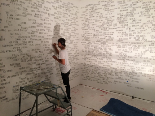 Amanda Eicher installing Geneology: Adobe Books, a relationship map of San Francisco's Mission Distict artist community of the 1990s.